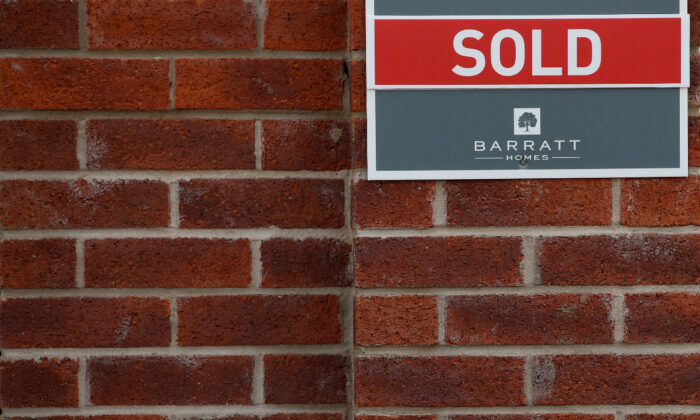 File photo of a 'Sold' sign is seen on the wall of a house in a new Barratt Homes housing development near Warrington, Britain, on Aug. 6, 2020. (Reuters/Phil Noble/File Photo)