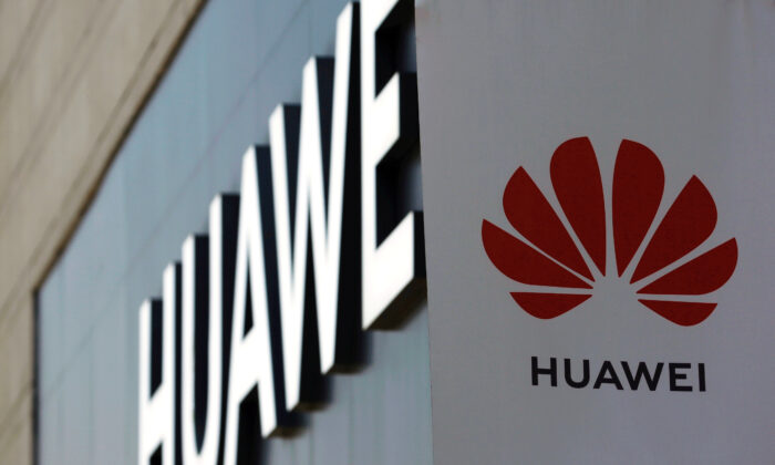 A Huawei sign is seen outside its store at a shopping complex in Beijing, China, on July 14, 2020. (Tingshu Wang/Reuters)