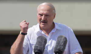 Lukashenko Says He Is Ready to Share Power in Belarus As Protests Mount