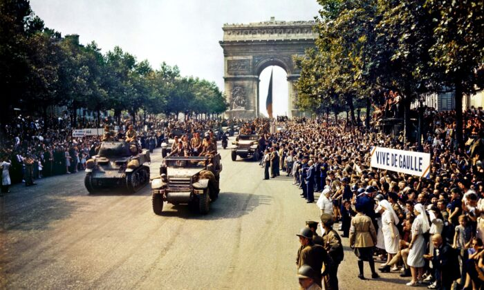 Crowds line the Champs Élysées as Free French Forces tanks and half-tracks pass through the Arc de Triomphe following the Liberation of Paris, on Aug. 26, 1944. (Public Domain)