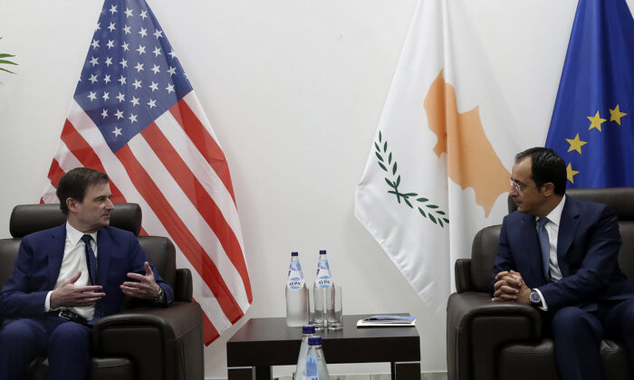 Cyprus' foreign minister Nikos Christodoulides, right, talks with Under Secretary of the United States of America, for Political Affairs, David Hale during their meeting at Larnaca international airport, Cyprus, on Aug. 16, 2020. (Christos Avraamides/Press and Information Office of Cyprus via AP Photo)