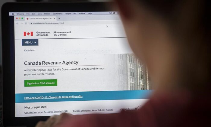 A person looks at a Canada Revenue Agency homepage in Montreal, on Aug. 16, 2020, as the COVID-19 pandemic continues in Canada and around the world. (The Canadian Press/Graham Hughes)