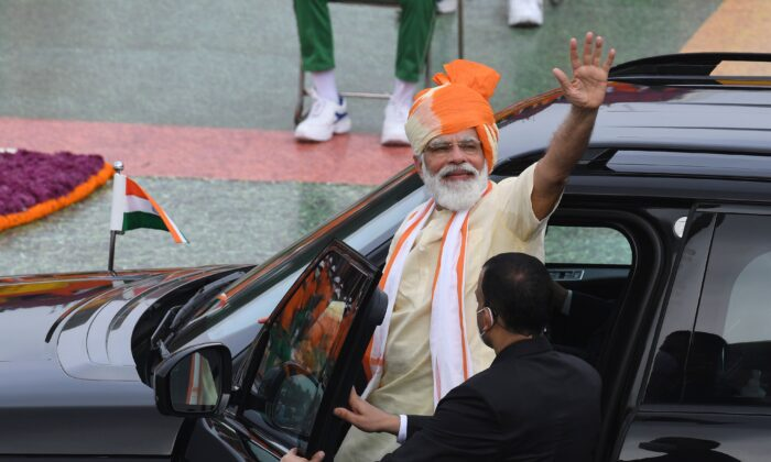India's Prime Minister Narendra Modi waves as he leaves in a car after his speech to the nation during a ceremony to celebrate India's 74th Independence Day, which marks the end of British colonial rule, at the Red Fort in New Delhi on Aug. 15, 2020. India's Prime Minister Narendra Modi issued a new warning to China over deadly border tensions on August 15, using his most important speech of the year to promise to build a stronger military. (PRAKASH SINGH/AFP via Getty Images)