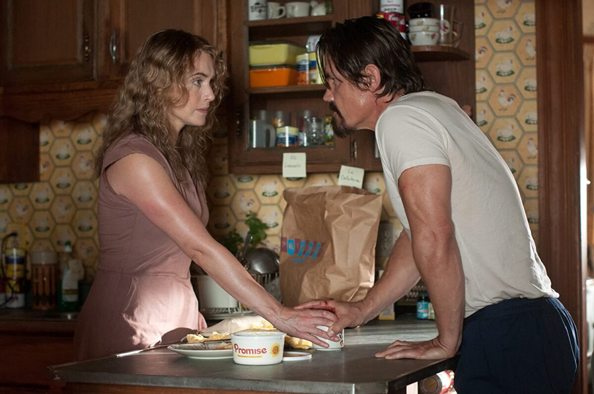 """man and woman at kitchen counter in """"Labor Day"""""""