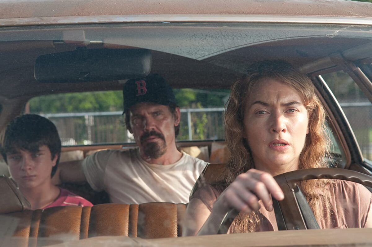 """man, boy, and woman in car in """"Labor Day"""""""
