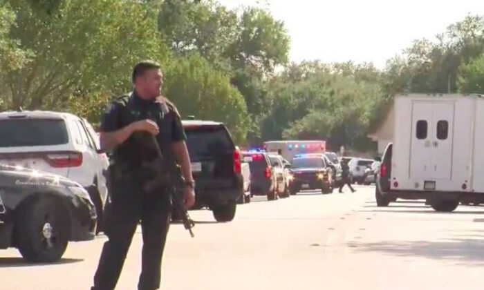 An officer stands near a home in Cedar Park, Texas, on Aug. 16, 2020, where a hostage situation was unfolding. (Courtesy of KTVT)