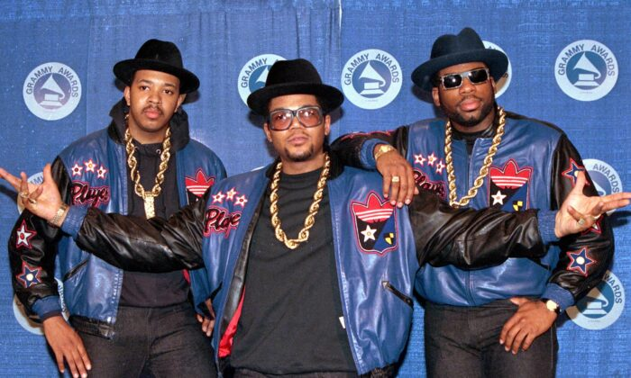 "The rap group Run-DMC, from left, Joseph ""Run"" Simmons, Darryl ""DMC"" McDaniels, and Jason Mizell ""Jam Master Jay,"" poses at the 31st annual Grammy Awards in New York City, on March 2, 1988. (Mark Lennihan/AP Photo)"