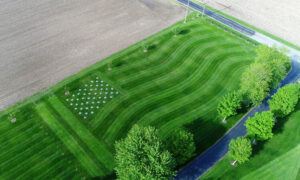 Coach Mows Giant US Flag in Lawn to Honor Fallen Soldier, a Former Wrestling Student