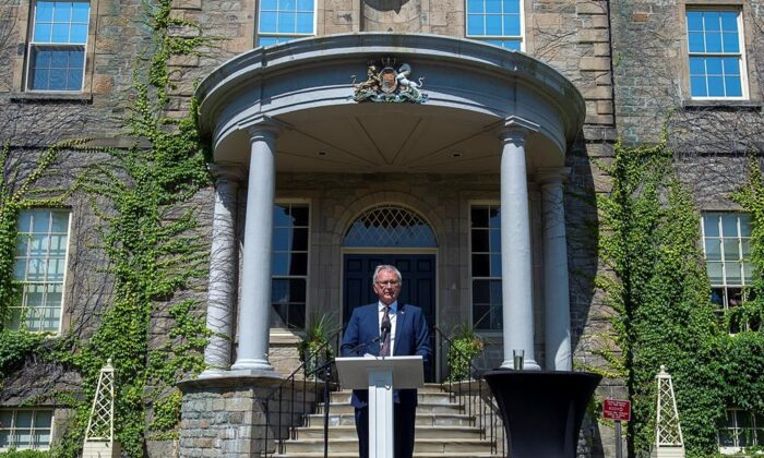 New Brunswick Premier Blaine Higgs talks with journalists after calling an election following a visit with Lt.-Gov Brenda Murphy at Government House in Fredericton on Aug. 17, 2020. The election will be held September 14. (Andrew Vaughan/The Epoch Times)