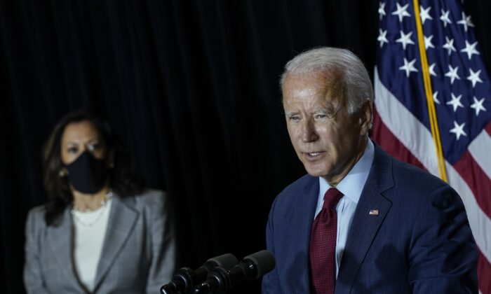 Presumptive Democratic presidential nominee Joe Biden, right, and Sen. Kamala Harris (D-Calif.) speak in a press conference in Wilmington, Del., on Aug. 13, 2020. (Drew Angerer/Getty Images)