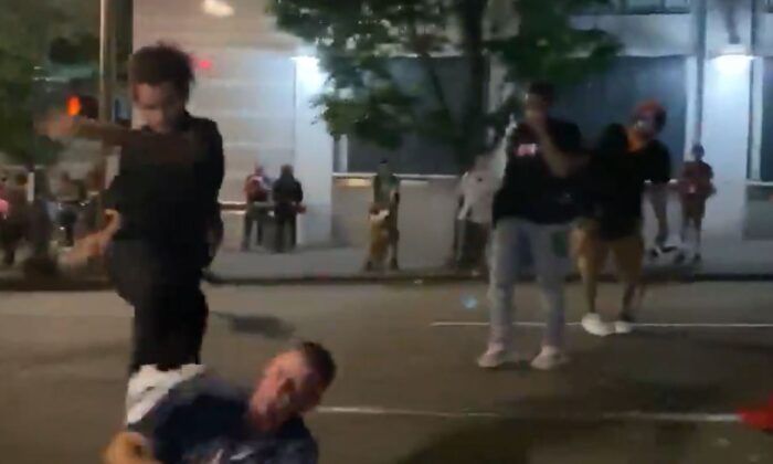 A man identified by police as Marquise Love (L) kicks Adam Haner in the face in Portland, Ore., on Aug. 16, 2020. (Kalen D'Almeida/Scriberr News)