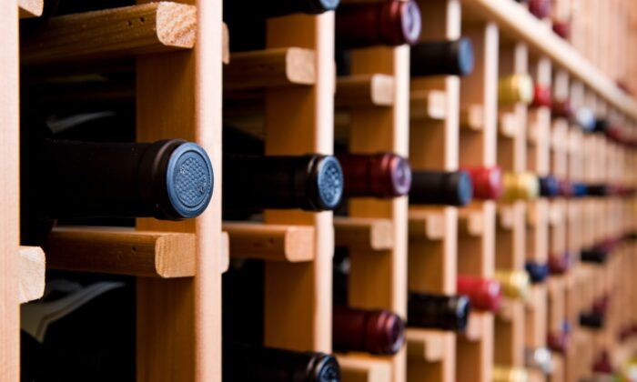 Start small, and you might find yourself working your way up to buying wooden wine racks and a refrigerated wine cabinet in no time. (Hdc Photo/Shutterstock)
