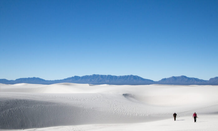 Hikers make their way through a five-mile loop trail in the heart of the dunes at White Sands National Park. (Courtesy of National Park Service)