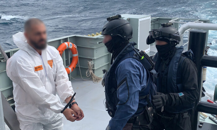 Law enforcement authorities arrest members of the Coralynne's crew on Aug. 15, 2020. (Australian Federal Police)