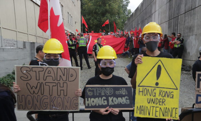 Protesters take part in a rally against the proposed Hong Kong extradition bill, in Vancouver on Aug. 17, 2019. (Darryl Dyck/The Canadian Press)