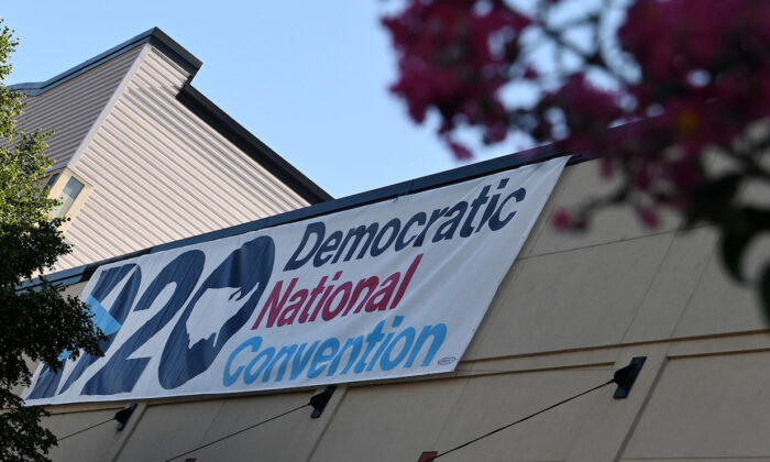 A banner of the Democratic National Convention hangs outside the Chase Center in Wilmington, Del., on Aug. 17, 2020. (Olivier Douliery/AFP via Getty Images)