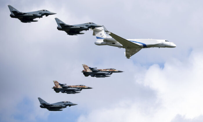 German air force Bundeswehr Eurofighters and an Israeli Air Force jets fly in formation over the Fuerstenfeldbruck airbase in commemoration of the 1972 Olympic Games assassination attempt in Fuerstenfeldbruck, Germany, on Aug. 18, 2020. (Sven Hoppe/dpa via AP Photo)