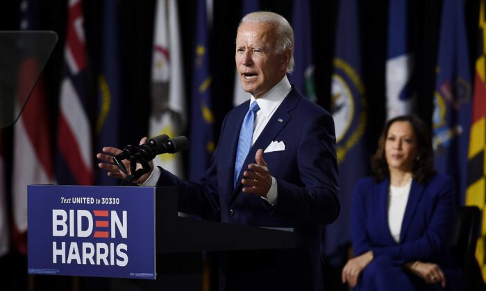 Democratic presidential nominee and former Vice President Joe Biden speaks as his vice presidential running mate, Sen. Kamala Harris, listens during their first press conference in Wilmington, Del., on Aug. 12, 2020. (Olivier Douliery/AFP via Getty Images)