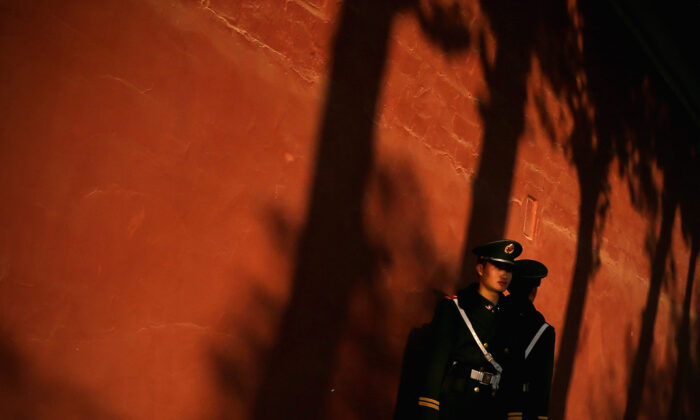 A paramilitary policeman guards outside the Great Hall of the People in Beijing on November 12, 2013. (Feng Li/Getty Images)