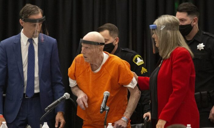 Joseph James DeAngelo, charged with being the Golden State Killer, is helped up by his attorney, Diane Howard, as Sacramento Superior Court Judge Michael Bowman enters the courtroom in Sacramento, Calif., on June 29, 2020. (Rich Pedroncelli/AP Photo)