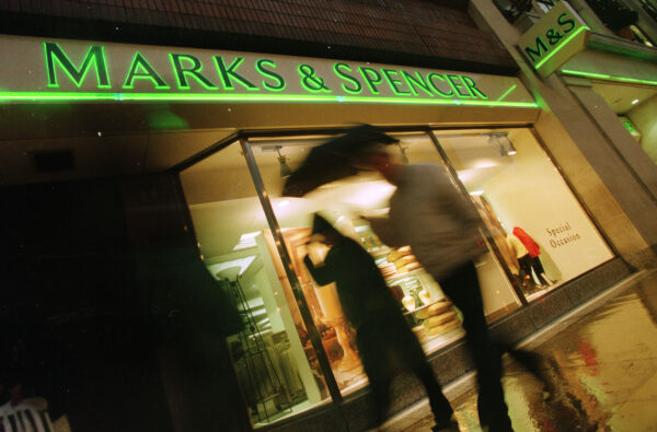 Marks and Spencer logo seen on an advertisement outside of a store in London