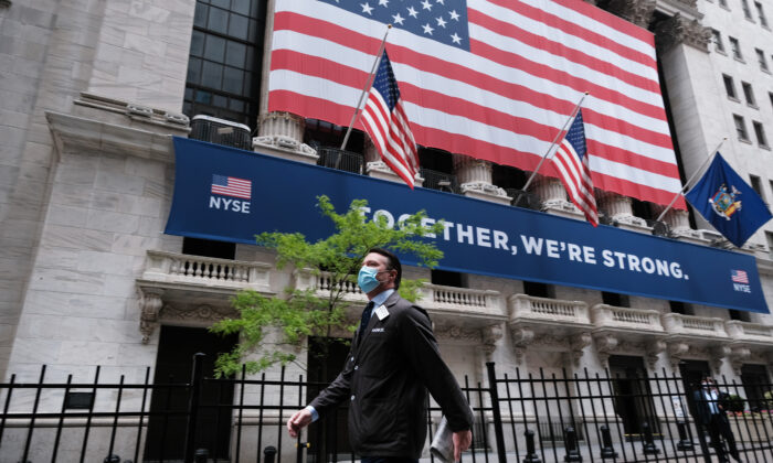 A trader walks by the New York Stock Exchange on May 26, 2020. (Spencer Platt/Getty Images)