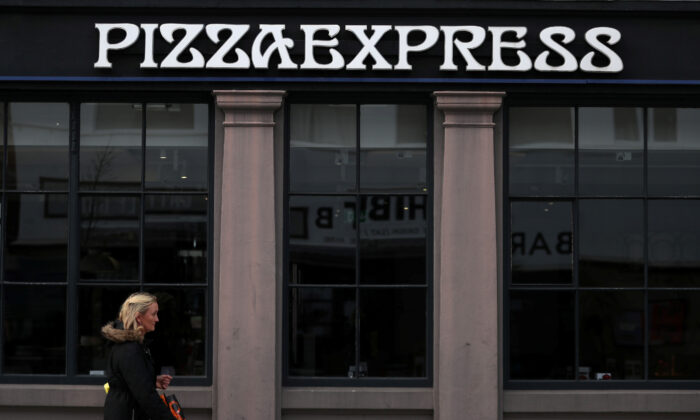 A woman walks past a Pizza Express restaurant in London, Britain, Oct. 16, 2019. (Hannah McKay/Reuters)