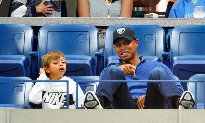 Tiger Woods and his son, Charlie Axel Woods, cheer on Rafael Nadal at 2019 US Open in New York City, N.Y., on Sept. 2, 2019.  (Gotham/GC Images)