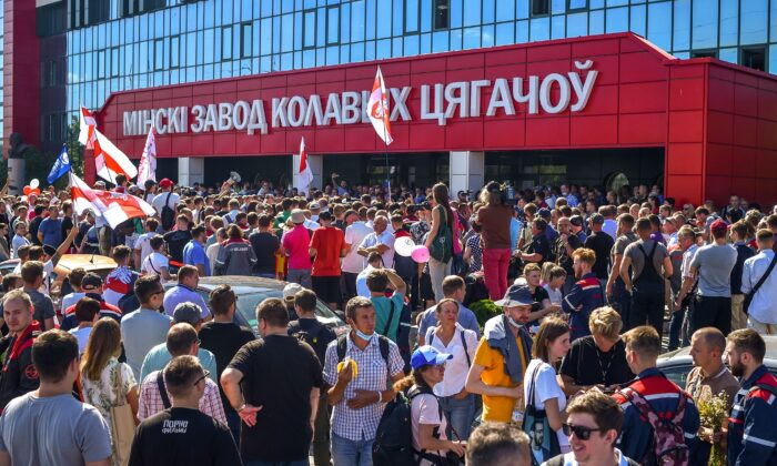 Belarus opposition supporters gather in front of the MZKT plant of the heavy off-road vehicles during a rally in Minsk, on Aug. 17, 2020, after incumbent president rejected calls to step down in a defiant speech. (Sergei Gapon/AFP via Getty Images)