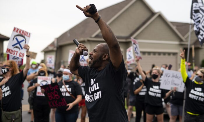 John Thompson, Minnesota Democratic candidate for district 67A, speaks during a protest outside the home of Minneapolis police union head Bob Kroll and WCCO reporter Liz Collin, in Hugo, Minn., on Aug. 15, 2020. (Stephen Maturen/Getty Images)