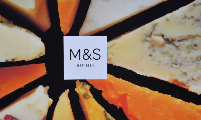 File photo showing a Marks and Spencer logo seen on an advertisement outside a store in London on May 23, 2018. (Reuters/Toby Melville)