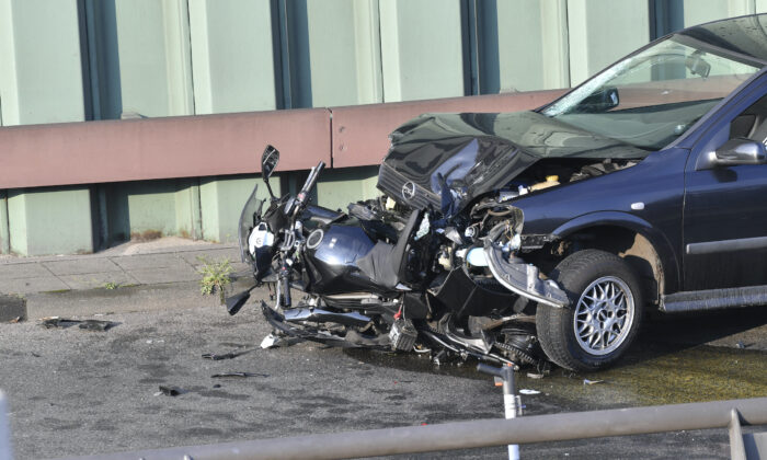 A car and a motorcycle stand on the city motorway A100 after an accident in Berlin,  on Aug. 19, 2020. (Paul Zinken/dpa via AP Photo)