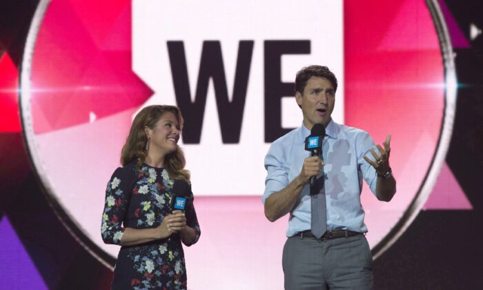 Canadian Prime Minister Justin Trudeau and Sophie Gregoire Trudeau appear on stage during WE Day UN in New York City on September 20, 2017. (Adrian Wyld/The Canadian Press)