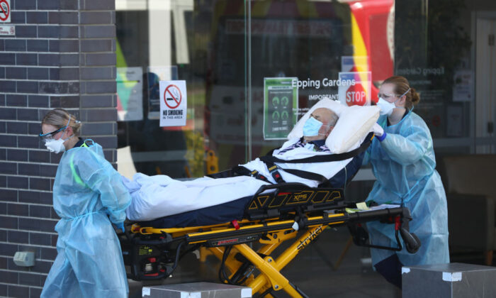 A resident is taken from the Epping Hardens Aged Care Home on July 29, 2020 in Melbourne, Australia. (Robert Cianflone/Getty Images)
