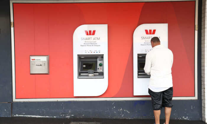 ATMs at a Westpac bank branch in 2017 in Melbourne, Australia. The pandemic has accelerated the digital payment shift of the country, with the number of ATMs nationwide fell from 27,870 to 25,720 during the June quarter (Robert Cianflone/Getty Images)