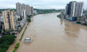 Typhoon, Floods Batter China as Heavy Rain Threatens Three Gorges Dam