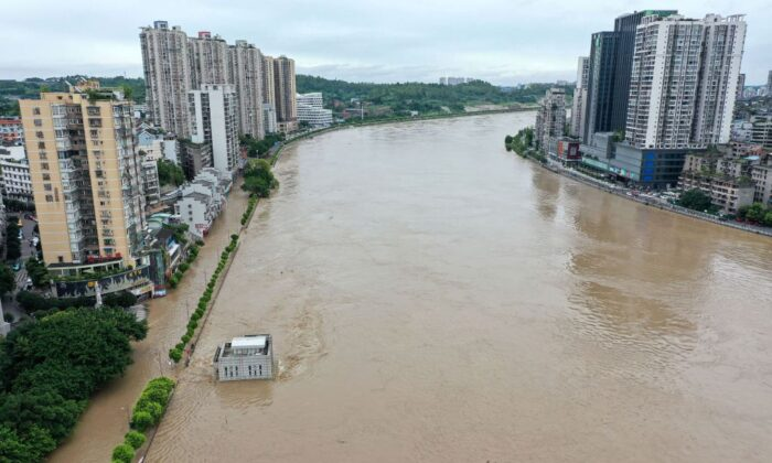 The swollen Tuojiang River following heavy rain in Neijiang in southwestern China's Sichuan Province on Aug. 18, 2020. (STR/AFP via Getty Images)