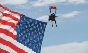 Double Amputee Ex-Green Barret Parachutes In With Giant US Flag at Veterans' Rally