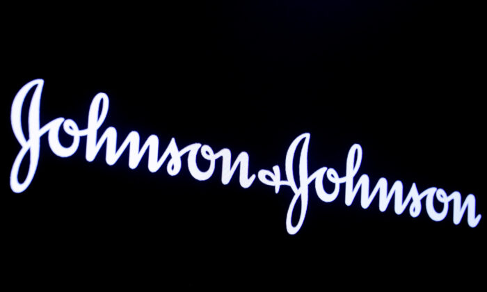 The company logo for Johnson and Johnson is displayed on a screen to celebrate the 75th anniversary of the company's listing at the New York Stock Exchange (NYSE) in New York City, on Sept. 17, 2019. (Brendan McDermid/Reuters/File Photo)
