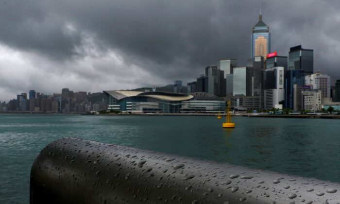 Rain droplets line a railing along the waterfront of Victoria Harbour in Hong Kong, China, on Aug. 19, 2020. (Vincent Yu/AP Photo)