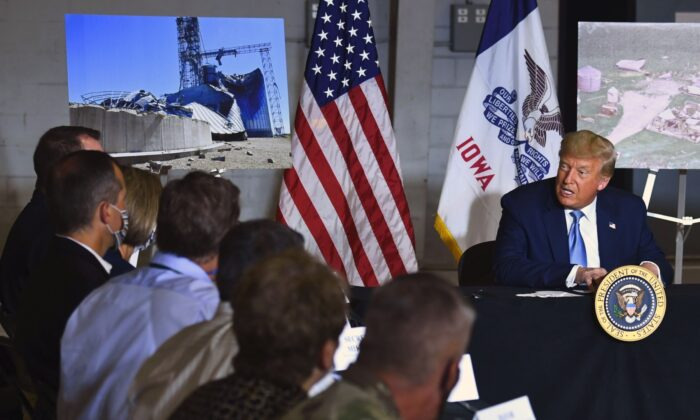 President Donald Trump participates in an Iowa Disaster Recovery Briefing at the Eastern Iowa Airport in Cedar Rapids, Iowa, on Aug. 18, 2020. (Brendan Smialowski/AFP via Getty Images)