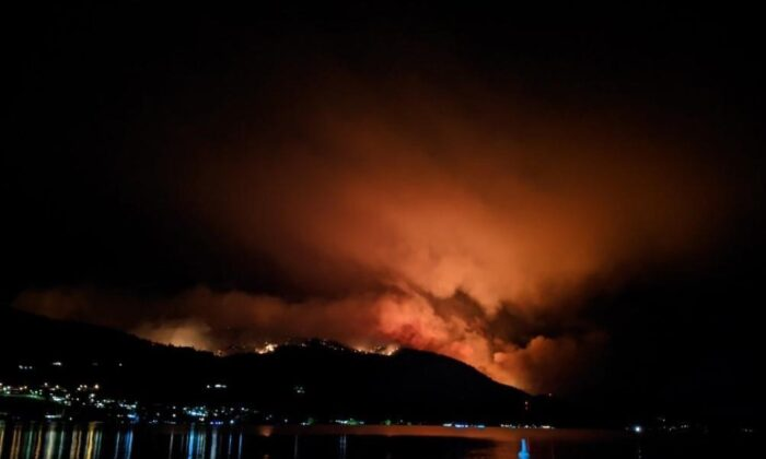 The Christie Mountain wildfire is shown on the East side of Skaha Lake near Okanagan Falls, B.C. in this image provided by the B.C. Wildfire Service late Tuesday evening, August 18, 2020. (The Canadian Press/HO-B.C. Wildfire Service)