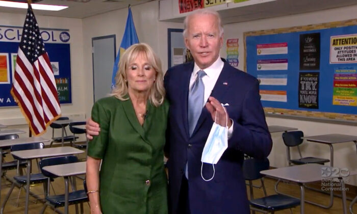 Democratic presidential candidate Joe Biden and his wife Jill Biden embrace as they speak from Brandywine High School, where she taught English from 1991 to 1993, during the virtual 2020 Democratic National Convention as participants from across the country are hosted over video links from the originally planned site of the convention in Milwaukee, Wisconsin, Aug. 18, 2020. (2020 Democratic National Convention/Pool via Reuters)