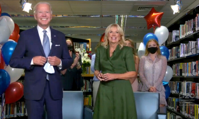Joe Biden, accompanied by his wife Jill Biden, celebrates after being formally nominated as 2020 U.S. democratic presidential candidate in convention roll call during the virtual 2020 Democratic National Convention as participants from across the country are hosted over video links from the originally planned site of the convention in Milwaukee, Wisconsin, on Aug. 18, 2020. (2020 Democratic National Convention/Pool via Reuters)