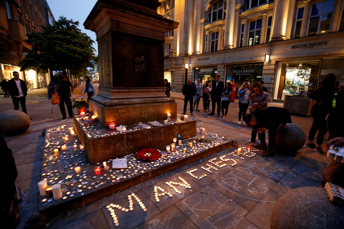 people attending a vigil for the victims of the Manchester Arena bombing, in central Manchester, Britain