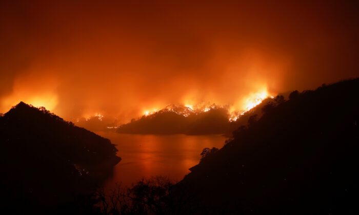 Flames are seen along the east side of Lake Berryessa during the LNU Lighting Complex Fire near Berryessa Highlands, Calif., on Aug 19, 2020. (Stephen Lam/Reuters)