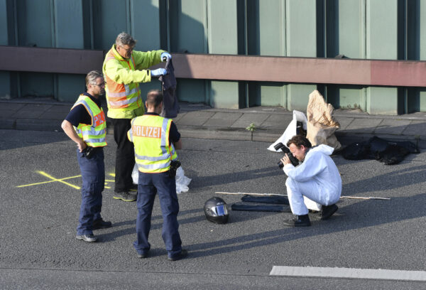 Police officers investigate on the city motorway A100 in Berlin