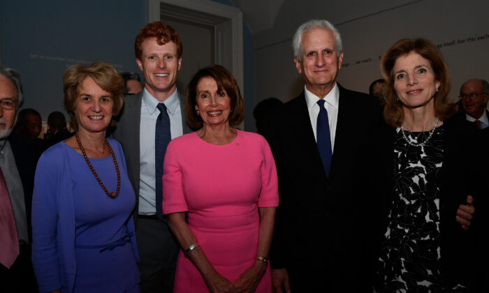 House Speaker Nancy Pelosi (D-Calif.), center, with Rep. Joe Kennedy, second from left, during an event in Washington in 2017. (Larry French/Getty Images for WS Productions)