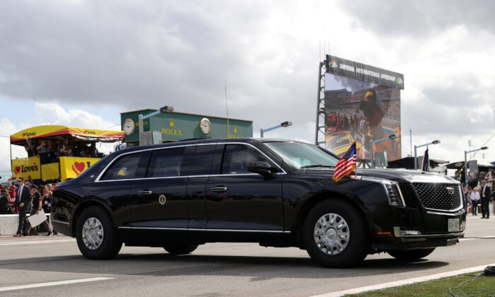 President Donald Trump and First Lady Melania Trump ride in the limousine, known as the Beast, on pit road prior to a NASCAR race in Daytona Beach, Fla., on Feb. 16, 2020. (Chris Graythen/Getty Images)