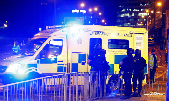 File photo shows armed police officers standing near the Manchester Arena, in Manchester, England, on 23, 2017. (Andrew Yates/Reuters)